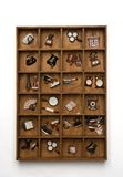 Wooden decorative wall shelf with ceramic objects. Royalty Free Stock Photos