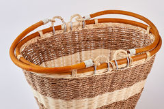 Wooden decorative wicker basket isolated. Brown and white textured bag royalty free stock image