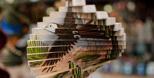 Wooden decorative wind spinner - 1 Stock Image