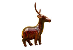 Wooden deer carving. Wooden deer carved on white background royalty free stock photos
