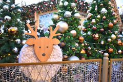 Wooden deer among the Christmas trees stock images