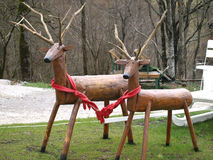 Wooden deer. In the park with a sleigh Stock Photos