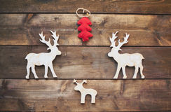 Wooden deer and red firtree Royalty Free Stock Photos