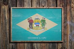 Wooden Delaware flag. 3d rendering of a Delaware State USA flag on a wooden frame and a wood wall Royalty Free Stock Images