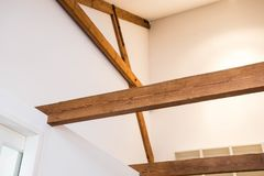 Wooden design. Wooden beams on ceiling as a design element. Modern interior. royalty free stock images