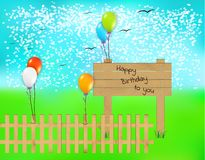 Wooden desk with happy birthday text and balloons Stock Photo