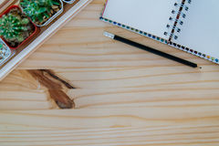 Wooden desk with notebook Stock Photos