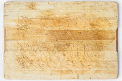 Wooden desk. Old and used natural wooden cooking board with cuts Royalty Free Stock Image
