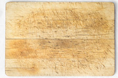 Wooden desk. Old and used natural wooden cooking board with cuts Royalty Free Stock Photos