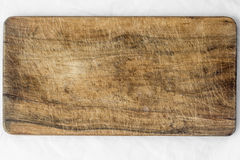 Wooden desk. Old and used natural wooden cooking board with cuts Royalty Free Stock Images