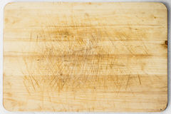 Wooden desk. Old and used natural wooden cooking board with cuts Stock Photography