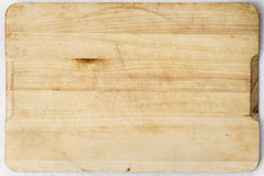 Wooden desk. Old and used natural wooden cooking board with cuts Stock Photos
