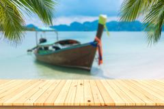 Wooden desk or plank on sand beach in summer. background. F. royalty free stock image