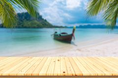 Wooden desk or plank on sand beach in summer. background. For product display Royalty Free Stock Photo