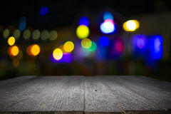 Wooden desk platform and bokeh at night Stock Photography