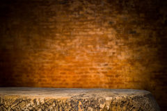 Wooden desk platform and brick wall background Stock Photo