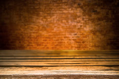 Wooden desk platform and brick wall background Royalty Free Stock Photo