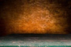 Wooden desk platform and brick wall background Stock Photos