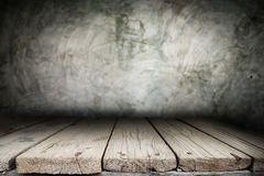 Wooden desk platform and polished concrete surface background Stock Image