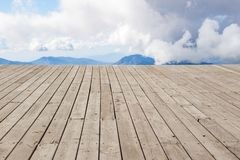 Wooden desk space, clouds and mountains. spring. Wooden desk space, clouds and mountains day stock images
