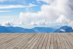 Wooden desk space, clouds and mountains. spring. Wooden desk space, clouds and mountains day stock photo