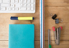 Wooden desk & stationery Royalty Free Stock Images