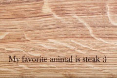 Wooden desk with a text. My favorite animal is steak royalty free stock photo