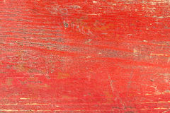 Wooden desk texture painted in red color Stock Image