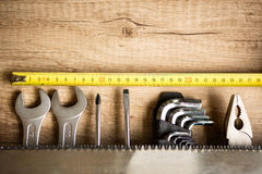 Wooden desk with tools and copy space Royalty Free Stock Photo