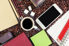 Wooden desk top with smartphone and coffee Royalty Free Stock Photos