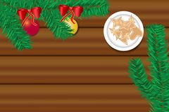 The wooden desk with twig of Christmas tree and Christmas sweets. Top view of the wooden desk with twig of Christmas tree with Christmas balls and Christmas Royalty Free Stock Photography