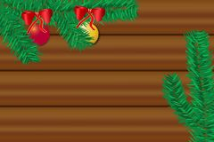 The wooden desk with twig of Christmas tree. Top view of the wooden desk with twig of Christmas tree with Christmas balls. Free place for your text is in the Stock Photography