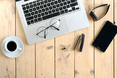 Wooden desk with various gadgets and accessories. Top view Royalty Free Stock Photos