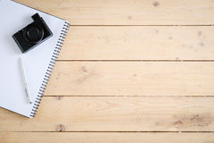 Wooden desk with various gadgets and accessories. Top view Royalty Free Stock Image