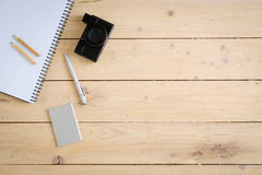 Wooden desk with various gadgets and accessories. Top view Stock Photo