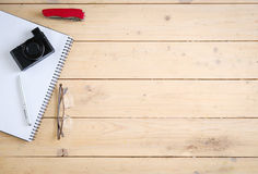 Wooden desk with various gadgets and accessories. Top view Stock Images