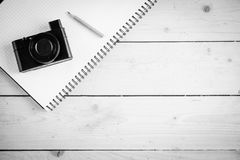 Wooden desk with various gadgets and accessories. Top view Royalty Free Stock Images