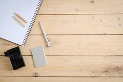 Wooden desk with various gadgets and accessories. Top view Stock Image