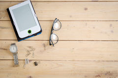 Wooden desk with various gadgets and accessories. Top view Stock Photos