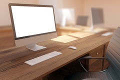 Wooden desk with white computer Stock Images