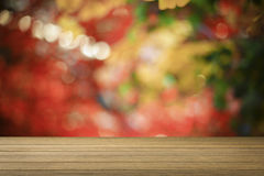 Wooden desk or wooden floor on bokeh light out of focus background.use for present or mock up your product. Stock Photography