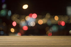 Wooden desk or wooden floor on night light bokeh background.use for present or mock up your product. Royalty Free Stock Photos