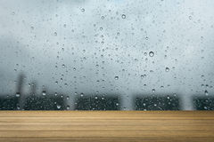 Wooden desk or wooden floor on water drop of the rain background.use for present or mock up your product. Stock Photos