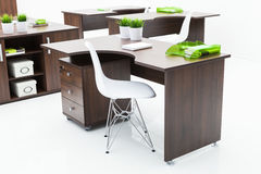 Wooden desks and white chairs Stock Photo
