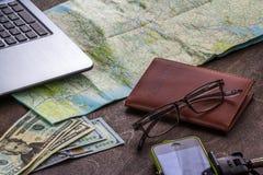Wooden Desktop of aTraveler Preparing for a Trip Stock Photos