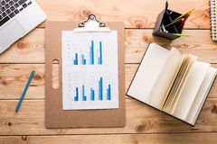 Wooden desktop with chart Royalty Free Stock Image