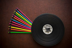 Wooden desktop with colorful pencil film reel and movie clapper Royalty Free Stock Photos
