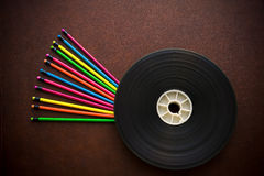 Wooden desktop with colorful pencil and movie film reel Royalty Free Stock Photography