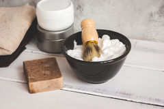 Wooden desktop with tools for shaving beards. Close up stock photo
