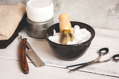 Wooden desktop with tools for shaving beards. Close up royalty free stock image